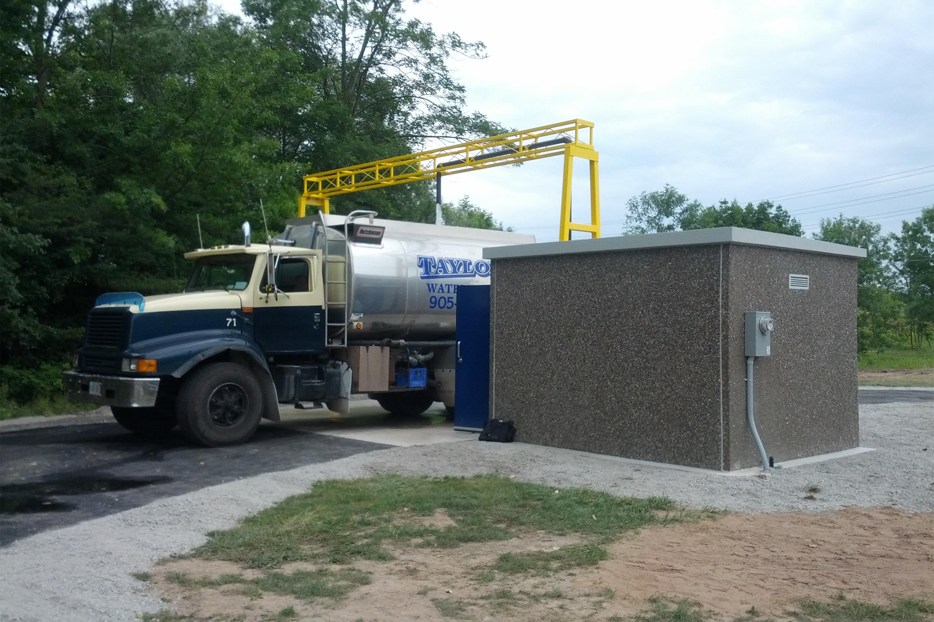 A water truck filling up using a Portalogic Bulk Water Fill Station in Niagara Falls, ON