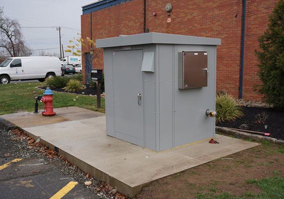A curbside Portalogic FS-72 Water Fill Station helps prevent illegal use of a nearby fire hydrant